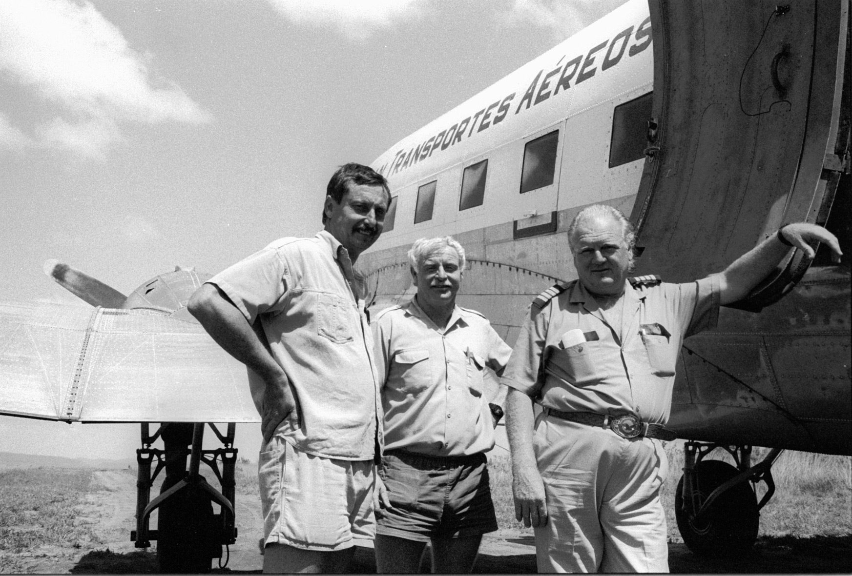 Mozambique, Sofala province, Marínguè. November 1993. The crew of Scan Air DC-3 (registration number: C/N 19006 C9-STE) during an airlift of emergency goods for displaced population. From left to right: Brian Nordan, John Murphy and chief pilot and Scan Air CEO Oscar Hermannson. The same team fatally crashed with this Douglas DC-3 near Molema in Tete province on 22 November 1993. Only John Murphy survived.