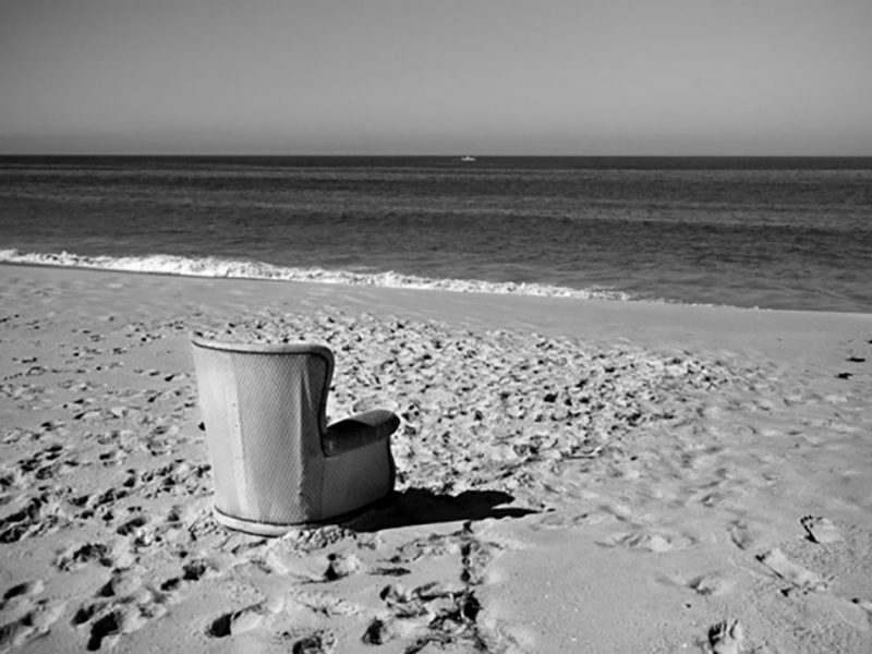 Portugal, Alentejo, Comporta. 'My favourite chair' on the beach of Torre, facing the Atlantic Ocean