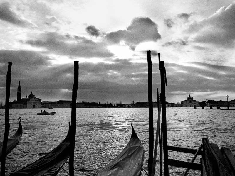 Italy, Venice. 2004. Gondolas at a wintery sunset at the Canal Grande.
