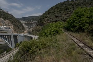 Portugal, Alto Douro, near the village of Tua. 2017. Part of the abandoned Tua railway line next to the completed Foz Tua Dam. Its storage reservoir is submerging a bigger part of this historic railroad that was built in 1887.