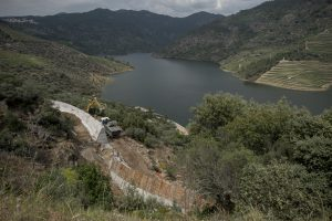 Portugal, Alto Douro, near the village of Tua. 2017. The storage reservoir of the Foz Tua dam that has completely submerged the historic Tua railway. A mooring is under construction to promote tourism (sic).