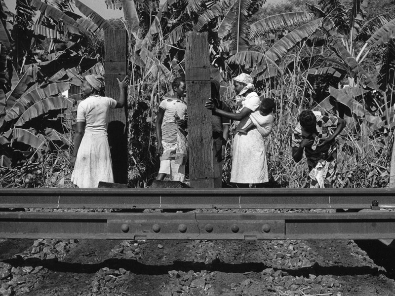 Mozambique, Manica province, Cafumbe. 1987. Women carry railway sleepers away from the Beira Corridor railway line. Timber sleepers are being replaced by steel ones under a railway rehabilitation programme.