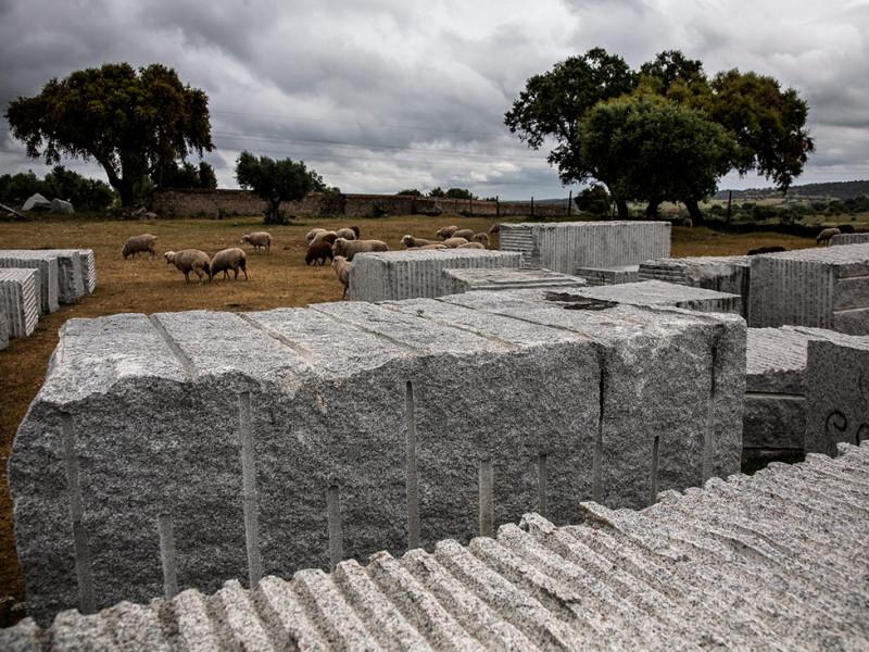 Portugal, Alentejo, Santa Eulália. 2011. Open-air storage of granite blocks.