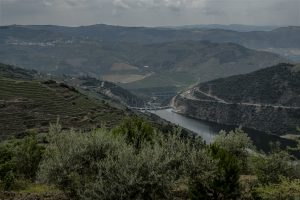 Portugal, Alto Douro. 2017. View from the village of Talhariz towards the Foz Tua Dam near the confluence of the Rivers Tua and Douro.